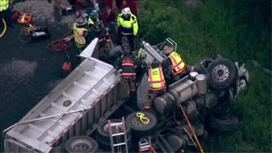 Dump Truck Flips on Turnpike Ramp; Pregnant Woman Shot; Smoking Rate Drops